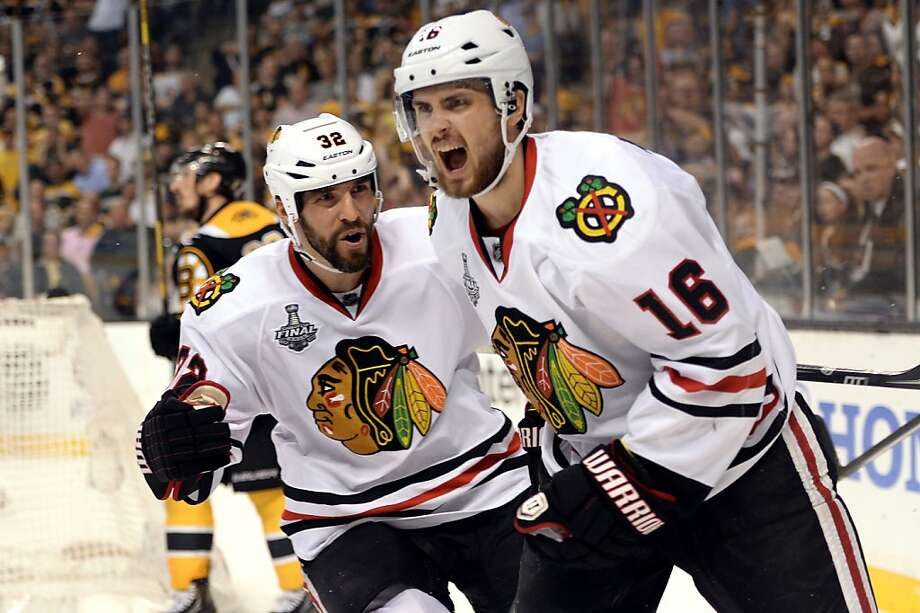 BOSTON, MA - JUNE 19:  Kaspars Daugavins #16 of the Boston Bruins celebrates with Michal Rozsival #32 after scoring a goal in the second period against the Boston Bruins in Game Four of the 2013 NHL Stanley Cup Final at TD Garden on June 19, 2013 in Boston, Massachusetts.  (Photo by Harry How/Getty Images) Photo: Harry How, Getty Images