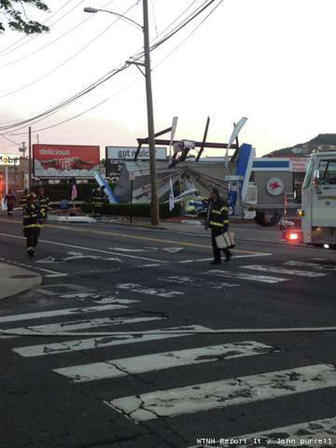 Two are dead after a car struck a gas station canopy on Amity Road in New Haven. Photo: Contributed Photo / Connecticut Post Contributed