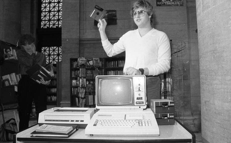 Jan. 8, 1983: Kim Cohan, the 18-year-old founder of Micro Timesharing Co., wows the press by unveiling a floppy disk, as he introduces the San Francisco library's first public computer.