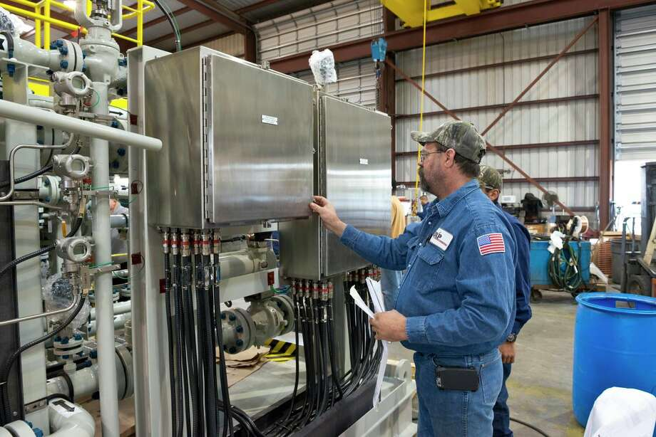 DXP Enterprises floor supervisor Steven Neiser completes final checks on the instrumentation wiring of a fuel gas skid.