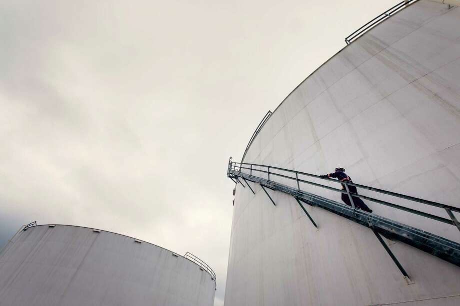 A Kinder Morgan employee climbs a holding container at the Kinder Morgan terminal facility in Galena Park. Photo: Â TODD SPOTH PHOTOGRAPHY, LLC / © TODD SPOTH PHOTOGRAPHY, LLC