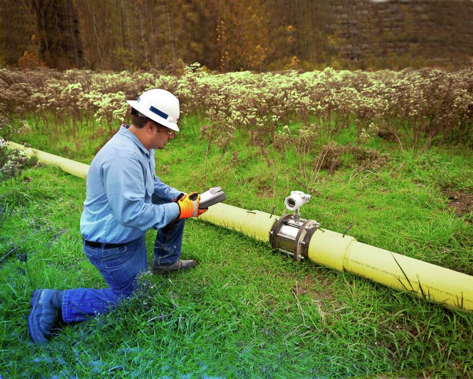 Rockwater's Steven Volas optimizes flow rate in a pipeline near Canonsburg, Pa.Keep going for a look at the biggest energy deals since the oil bust. Photo: Dustin Brown
