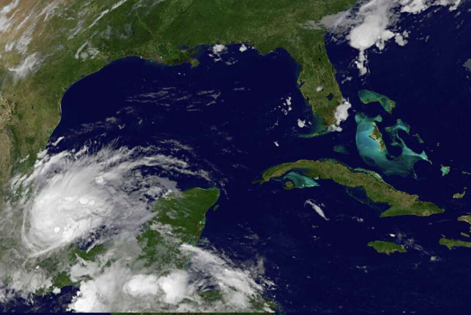 This image provided by NOAA shows Tropical SStorm Barry taken at 4:45 a.m. EDT Thursday June 20, 2013. The U.S. National Hurricane Center said the storm was about 30 miles (45 kilometers) north of the port city of Veracruz early Thursday and heading west at 5 mph (7  kph). Barry, which has sustained 45-mph (75-kph) winds, is expected to make landfall northwest of that city. (AP Photo/NOAA) Photo: HOPD / NOAA