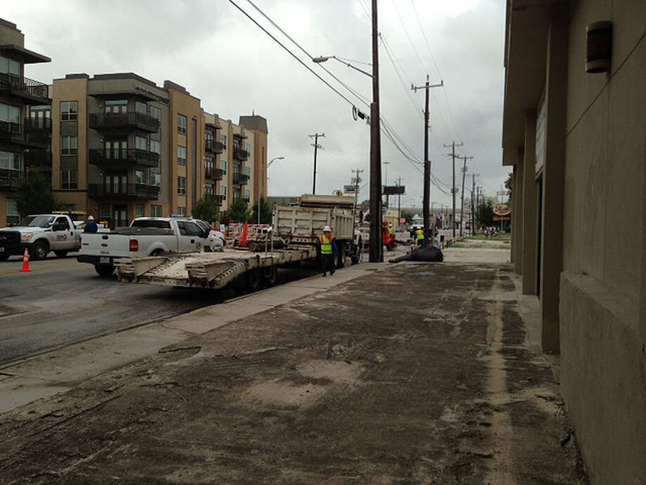 CPS works on the 1800 block of Broadway Street around 8:45 a.m., June 20, 2013. Photo: Julie Ruff / MySA.com