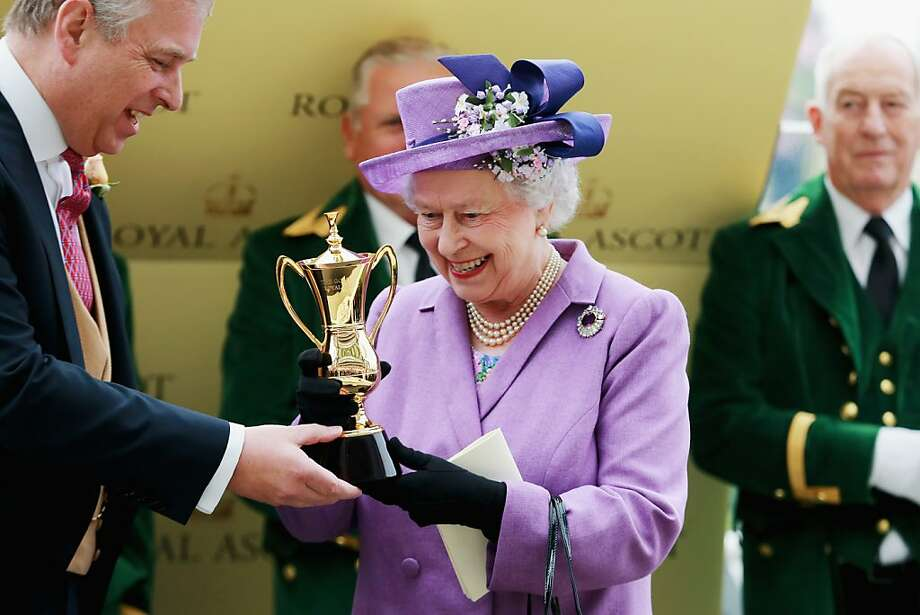 Queen Elizabeth II holds the Gold Cup after Ryan Moore, riding Estimate, won The Gold Cup during Ladies' Day on day three of Royal Ascot. Photo: Chris Jackson, (Credit Too Long, See Caption)