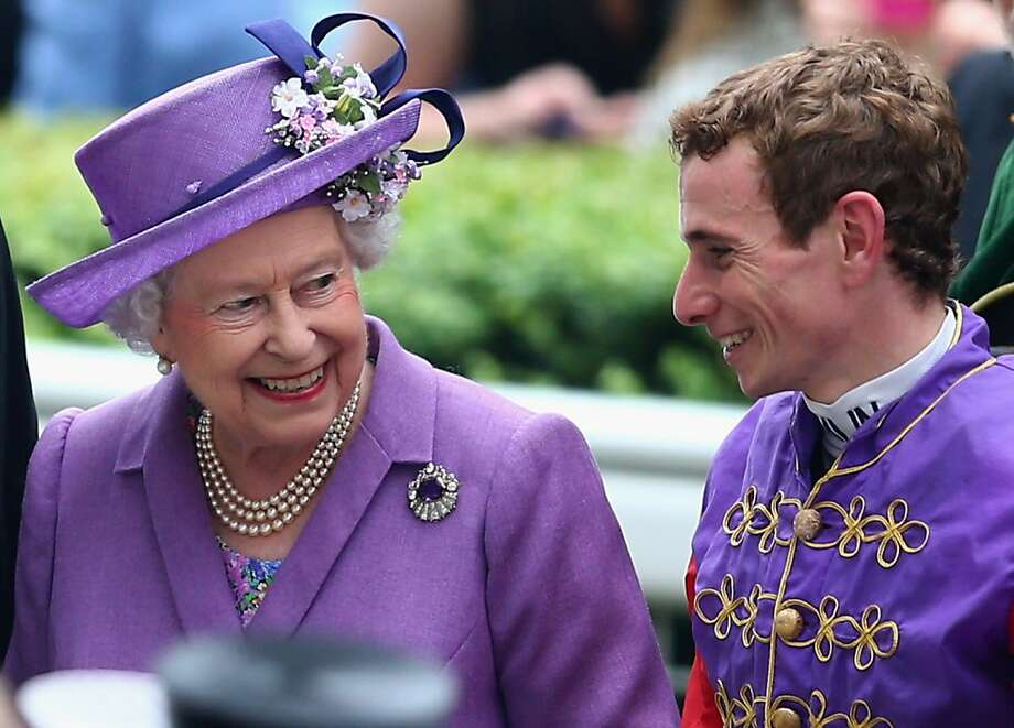 Queen Elizabeth II talks with jockey Ryan Moore after the Queen's horse won The Gold Cup on Ladies' Day during day three of Royal Ascot at Ascot Racecourse on June 20, 2013 in Ascot, England. Photo: Paul Gilham, Getty Images