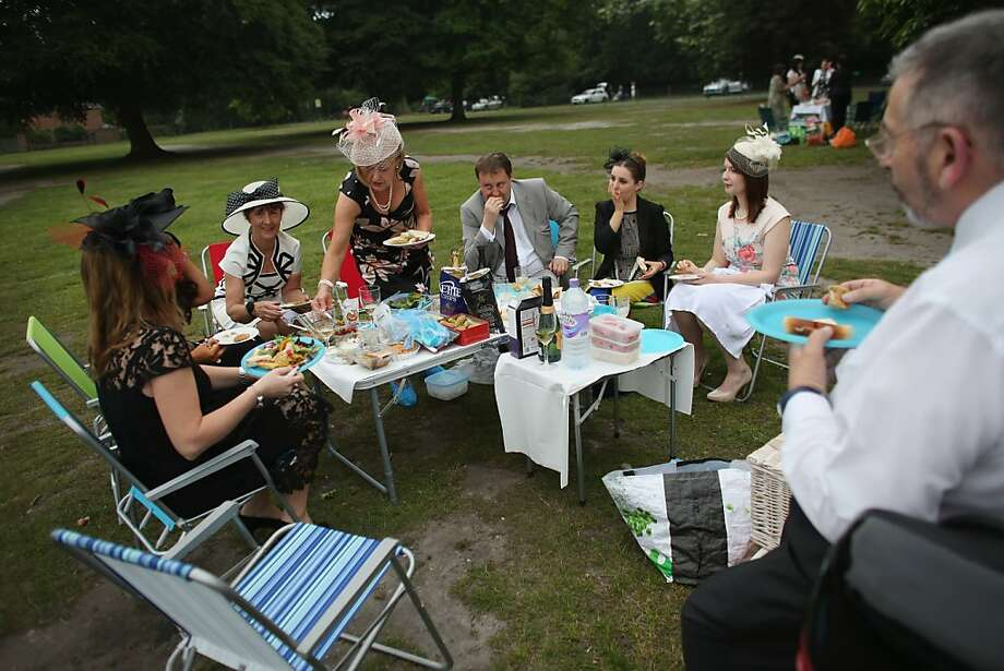 Racegoers picnic by their car adjacent to Ascot racecourse before attending Royal Ascot on June 20, 2013 in Ascot, England. The 'Royal Ascot' horse race meeting runs from June 18, 2013 until June 22, 2013 and has taken place since 1711. Photo: Oli Scarff, Getty Images