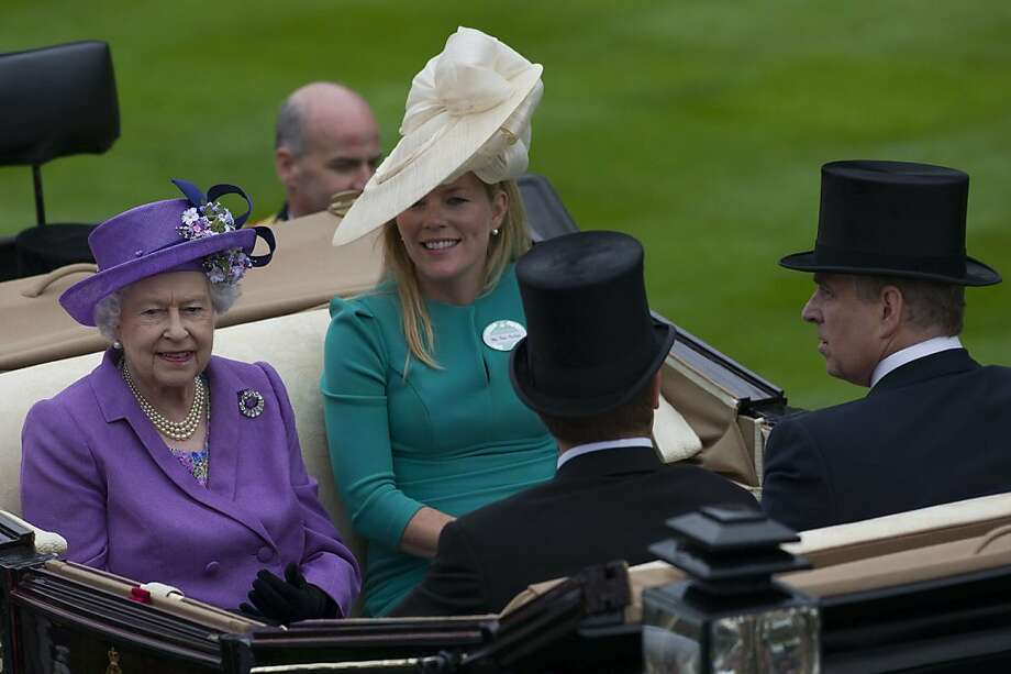 Britain's Queen Elizabeth II (L) arrives with Autumn Phillips (far right), Britain's Prince Andrew, The Duke of York (R) and Peter Phillips on the third day of Royal Ascot, in Berkshire, west of London, on June 20, 2013.  Photo: Carl Court, AFP/Getty Images