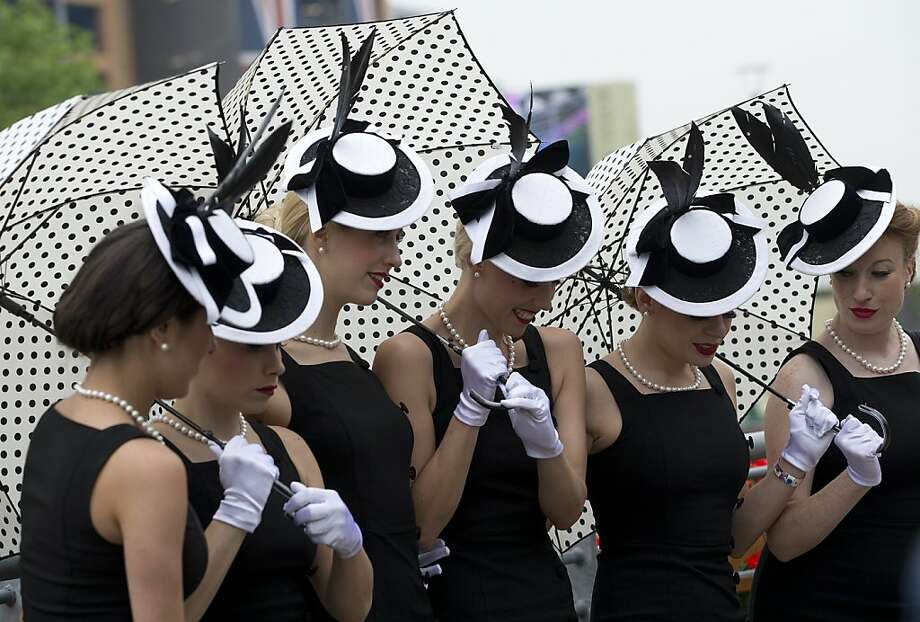A vocal group line up as they pose for the media on the third day traditionally known as Ladies Day of the Royal Ascot horse race meeting in Ascot, England, Thursday, June 20, 2013. (AP Photo/Alastair Grant) Photo: Alastair Grant, Associated Press