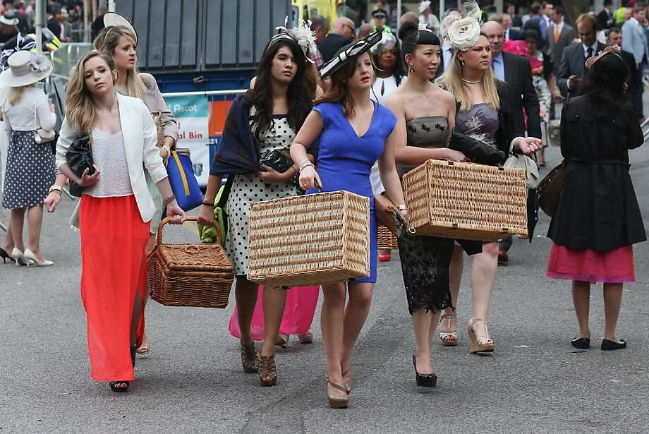Race-goers carry hampers to Ascot racecourse to attend Royal Ascot on June 20, 2013 in Ascot, England.  Photo: Oli Scarff, Getty Images