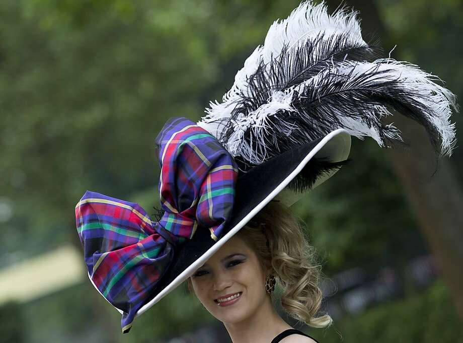 Mimi Theobald poses for the media with an ornate hat on the third day traditionally known as Ladies Day of the Royal Ascot horse race meeting in Ascot, England, Thursday, June 20, 2013. (AP Photo/Alastair Grant) Photo: Alastair Grant, Associated Press