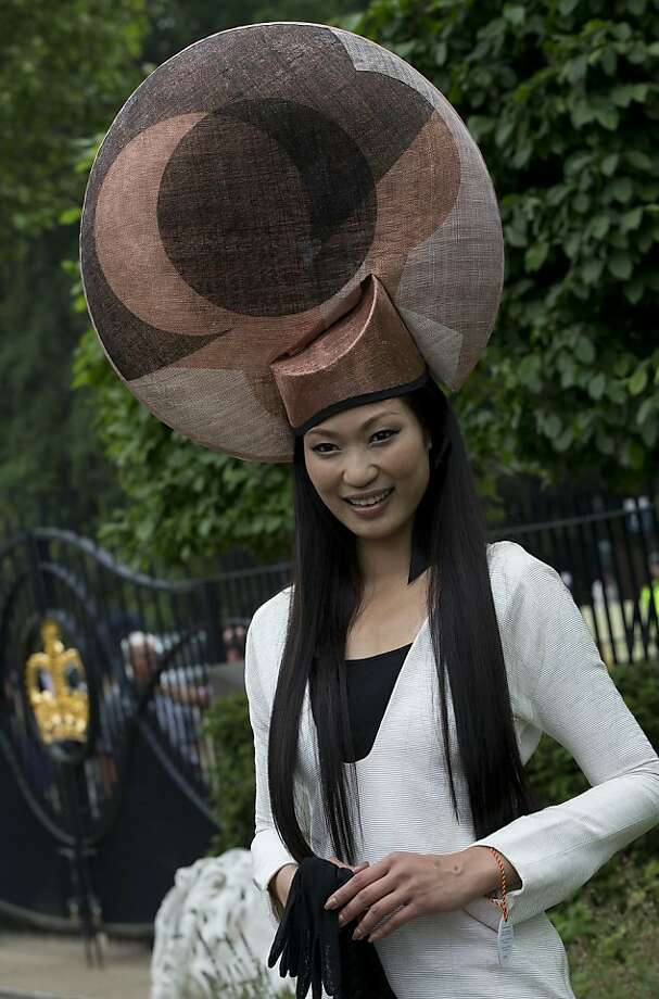 Wei Lin from Taiwan  wears an ornate hat on the third day traditionally known as Ladies Day of the Royal Ascot horse race meeting in Ascot, England, Thursday, June 20, 2013.  Photo: Alastair Grant, Associated Press