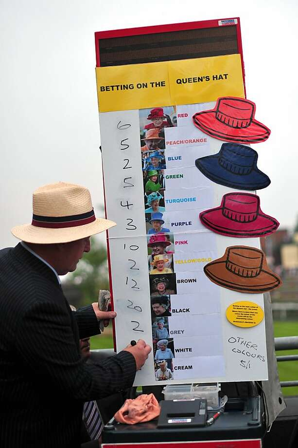 A bookmaker takes bets on the color of the hat that Queen Elizabeth II will be wearing on the third day of Royal Ascot. The five-day meeting is one of the highlights of the horse racing calendar. Horse racing has been held at the famous Berkshire course since 1711. Top hats and tails remain compulsory in parts of the course while a daily procession of horse-drawn carriages brings the Queen to the course. Photo: Carl Court, AFP/Getty Images
