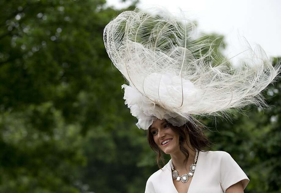A racegoer wears an ornate hat on the third day traditionally known as Ladies Day of the Royal Ascot horse race meeting in Ascot, England, Thursday, June 20, 2013. (AP Photo/Alastair Grant) Photo: Alastair Grant, Associated Press