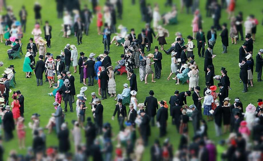 Guests mingle in the Royal Enclosure at Royal Ascot on June 19, 2013 in Ascot, England. Men are required to wear tails. Photo: Chris Jackson, Getty Images