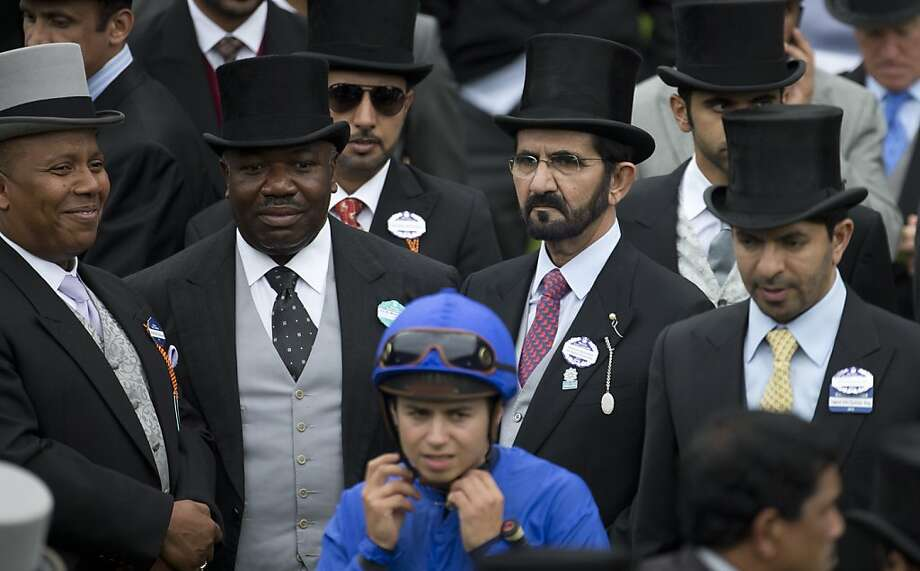 Sheik Mohammed Bin Rashid Al Maktoum, second right watches his jockey for the Prince of Wales's Stakes Mackeal Barzalona, foreground before mounting up on the second day of the Royal Ascot horse race meeting in Ascot, England, Wednesday, June 19, 2013. (AP Photo/Alastair Grant) Photo: Alastair Grant, Associated Press