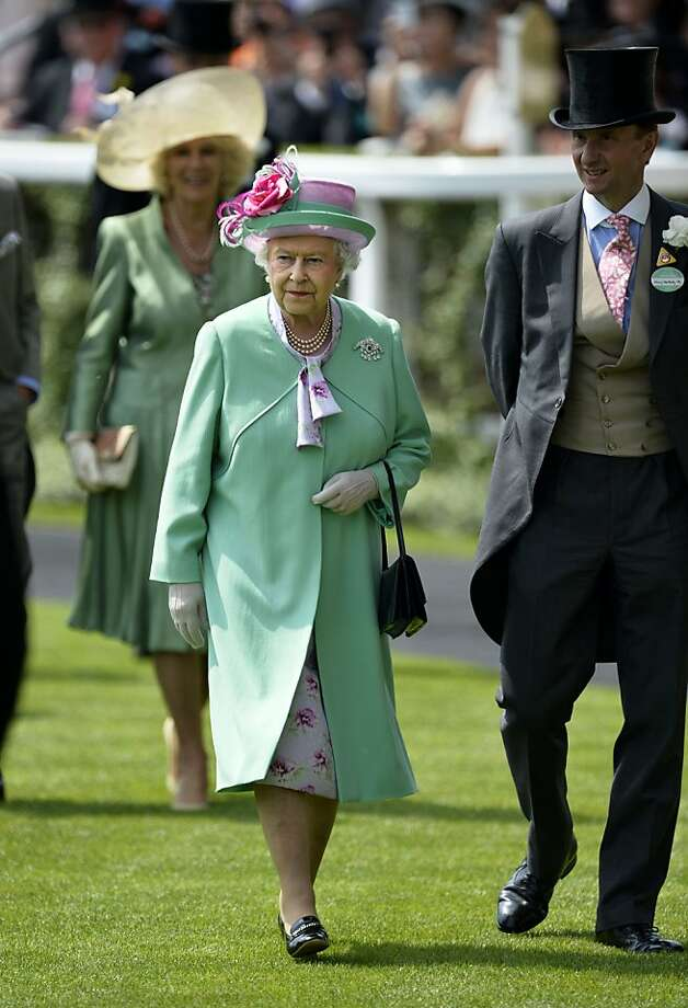 Britain's Queen Elizabeth II walks through the parade ring during the second day of Royal Ascot. Photo: Adrian Dennis, AFP/Getty Images