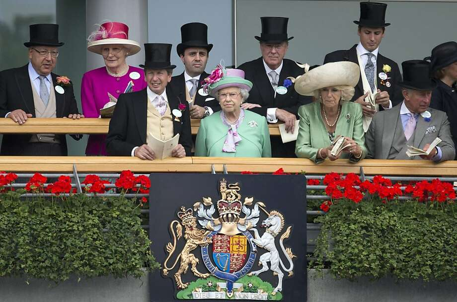 Britain's Queen Elizabeth II, second left, looks ous as she watches the parade ring with John Warren her racing manager, left, Camilla, Duchess of Cornwall, and Prince Charles on the second day of the Royal Ascot horse race meeting in Ascot, England, Wednesday, June 19, 2013. (AP Photo/Alastair Grant) Photo: Alastair Grant, Associated Press