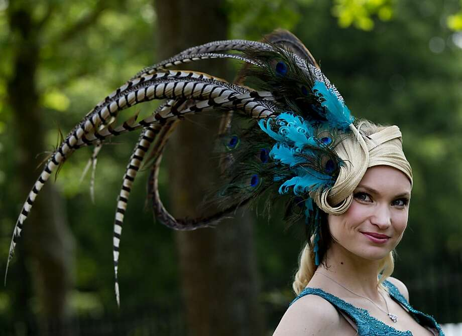 Marinilia Smirnova poses for the media wearing a peacock feather hat on the second day of the Royal Ascot horse race meeting in Ascot, England, Wednesday, June 19, 2013. Photo: Alastair Grant, Associated Press