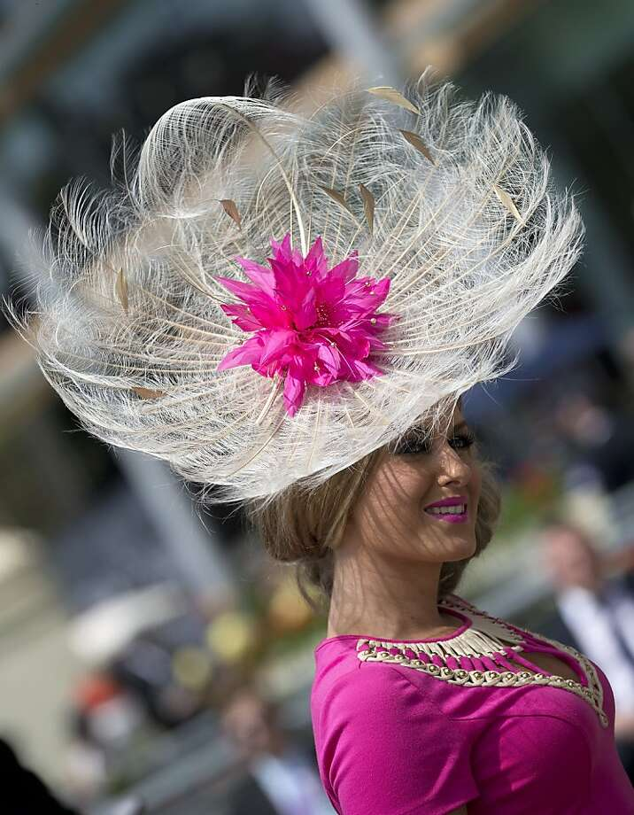 Ashleigh Johns wears an ornate feather based hat on the second day of the Royal Ascot horse race meeting in Ascot, England, Wednesday, June 19, 2013. (AP Photo/Alastair Grant) Photo: Alastair Grant, Associated Press