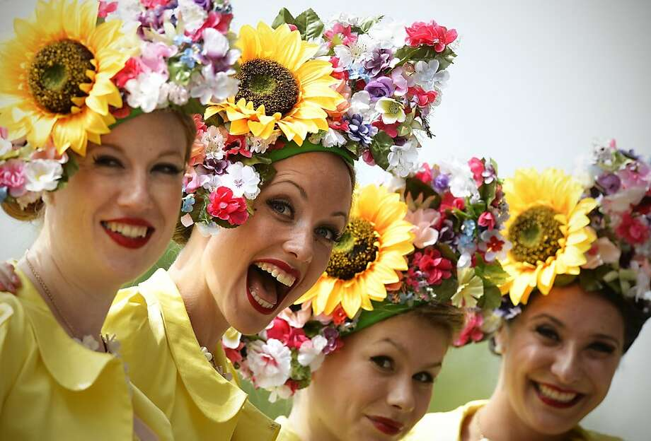 Members of The Tootsie Rolls, a retro girl band, pose for pictures during the second day of Royal Ascot. Photo: Adrian Dennis, AFP/Getty Images