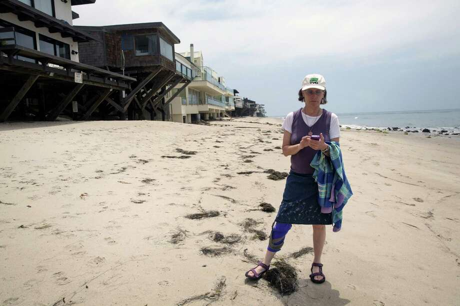 Jenny Price developed an app to help users find hidden public beach paths amid multimillion dollar homes in Malibu, Calif. Photo: New York Times