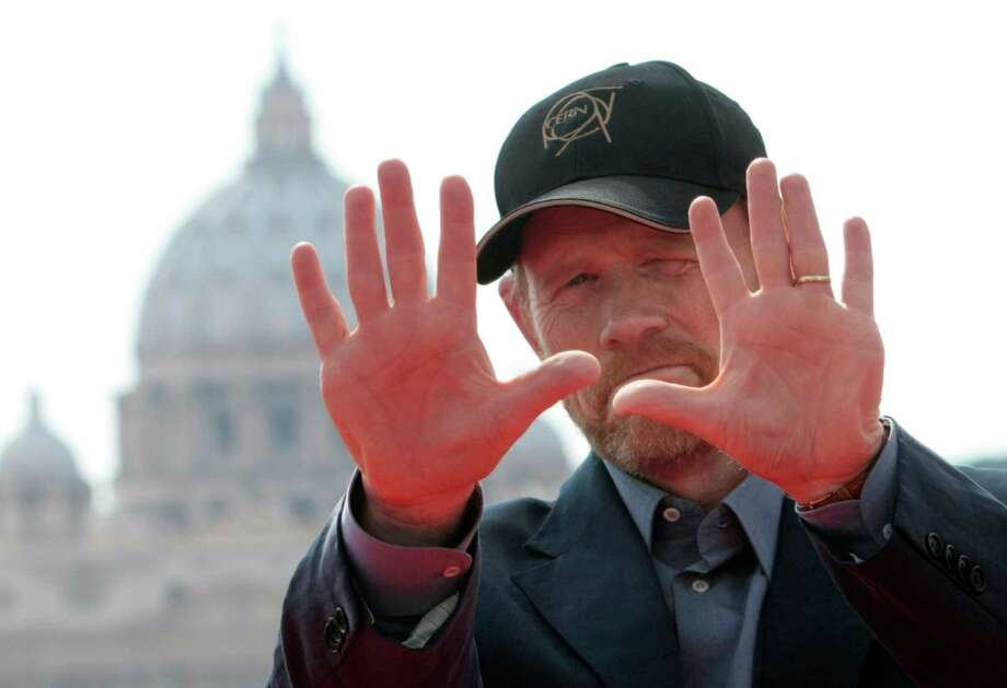 "Director Ron Howard gestures by framing photographers during the photo call for the World Premiere of the movie ""Angels & Demons"", in front of St. Peter's Basilica, in Rome, Sunday, May 3, 2009. Photo: ANDREW MEDICHINI, AP Photo/Andrew Medichini / Associated Press"