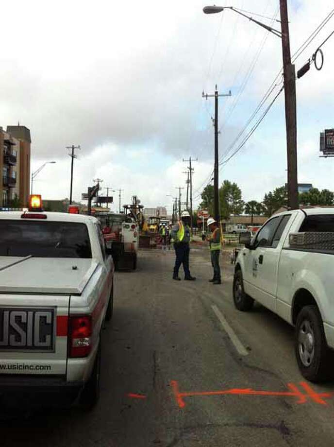 CPS Energy works in the 1800 block of Broadway Street where a water main broke overnight. Photo: Ana Ley/Express-News