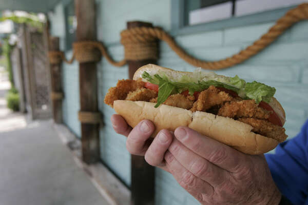 A fried shrimp po-boy is a featured dish as served at Shrimp N Stuff. (Chronicle file)