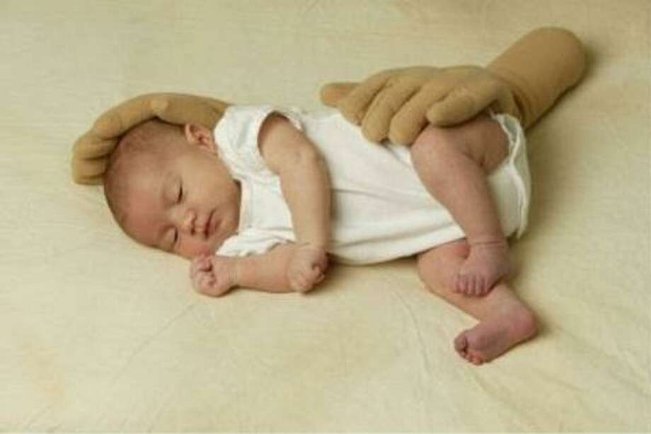 The Zacky Hand Pillow: Brilliant? Yes! But also a little creepy. This product was actually designed for preemies in the NICU who can't be at their parents' side 24/7. Photo: Nurtured By Design