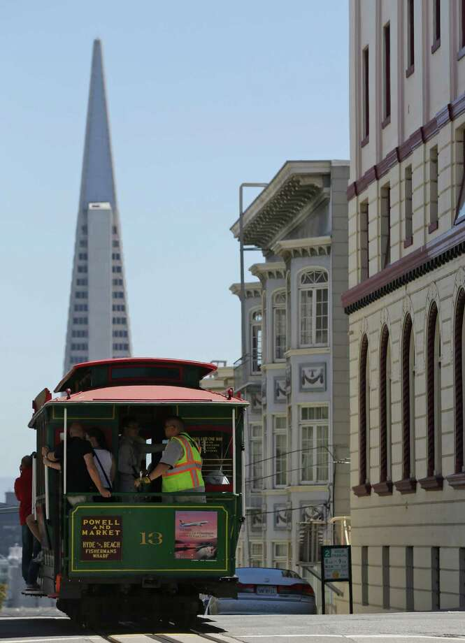 Visitors ride the Powell and Market cable car line in San Francisco. A San Antonio Express-News reader warns San Antonio about the streetcar problems in San Francisco. Photo: Marcio Jose Sanchez, Associated Press / AP
