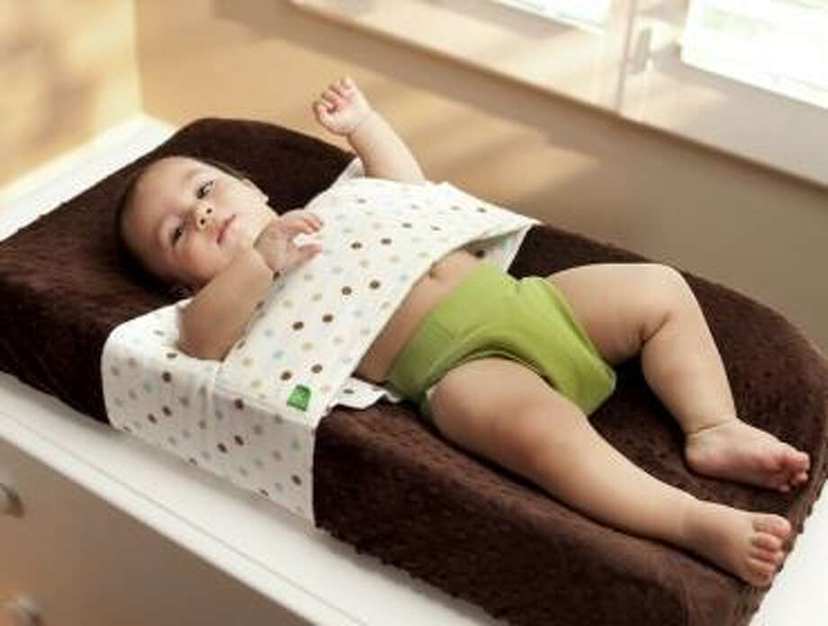 The Happy Changer: Got a squirmy-wormy kid? This product that allows you to strap down your kid will make changing diapers a breeze. No more poop on the walls! Photo: Hulabye