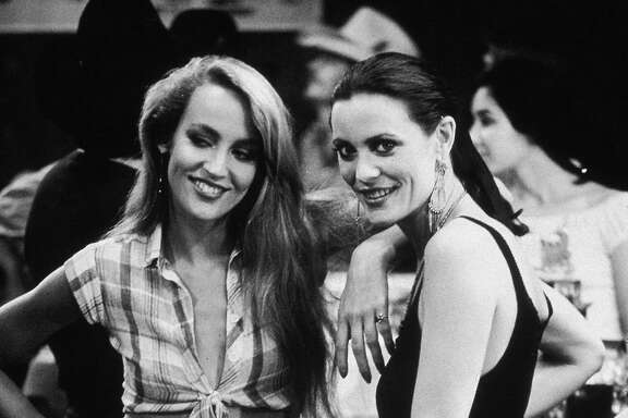1980, American model and actor Jerry Hall and her sister, Cindy, at a party for director James Bridges's film 'Urban Cowboy' held at Gilley's, in Pasadena, Texas.