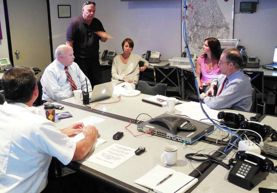 Westport officials simulate a response to an ice storm in the northwest region of the state from the town's Emergency Operations Center. Photo: Contributed Photo / Westport News