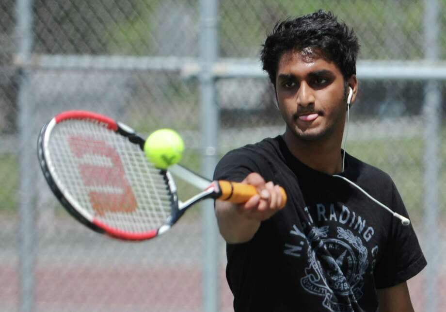 Arvind Manepalli, of Bethel, plays tennis at the practice wall at Rogers Park in Danbury, Conn. on Thursday, June 20, 2013. Photo: Tyler Sizemore / The News-Times