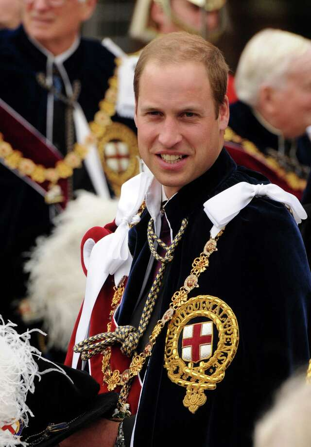 Britain's Prince William, Duke of Cambridge, takes part in the annual parade for members of the Order of the Garter at Windsor Castle in Berkshire, west of London on June 17, 2013. Prince William joined The Queen and other members of the royal family for the annual Order of the Garter service. The Order of the Garter is the pinnacle of the UK honours system with appointments of Knights of the Garter a perogative of the Queen, and a gift that is made without consulting ministers. Prince Charles, Prince of Wales and Prince William are both knights of the order.  AFP PHOTO / POOL / EAMONN M. McCORMACKEAMONN M. MCCORMACK/AFP/Getty Images Photo: EAMONN M. MCCORMACK / AFP