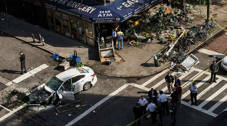 Car vs. grocery: At least eight people were injured when a Nissan Altima crashed into a 