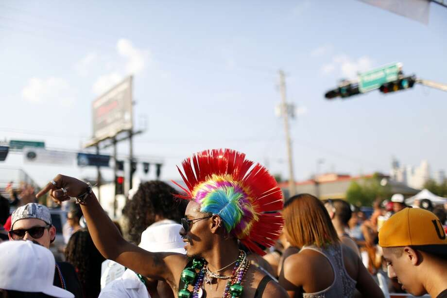 A festival goer wears a brightly colored mohawk, Saturday, June 24, 2012, during the Houston Pride Parade, in Montrose in Houston, Texas. (Todd Spoth / For The Chronicle)