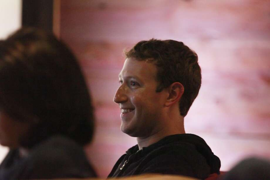 Facebook CEO Mark Zuckerberg listens to Kevin Systrom (not shown), Instagram CEO and co-founder, speak during a press event at Facebook headquarters where a video feature for Instagram was announced on Thursday, June 20, 2013 in Menlo Park,  Calif.