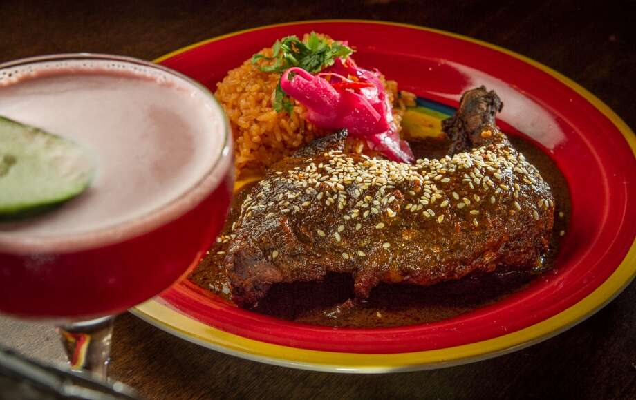 The Chicken with Mole Poblano and a Jamaicazo Margarita at at El Gusano in Oakland, Calif., is seen on Thursday,  June 13th, 2013.
