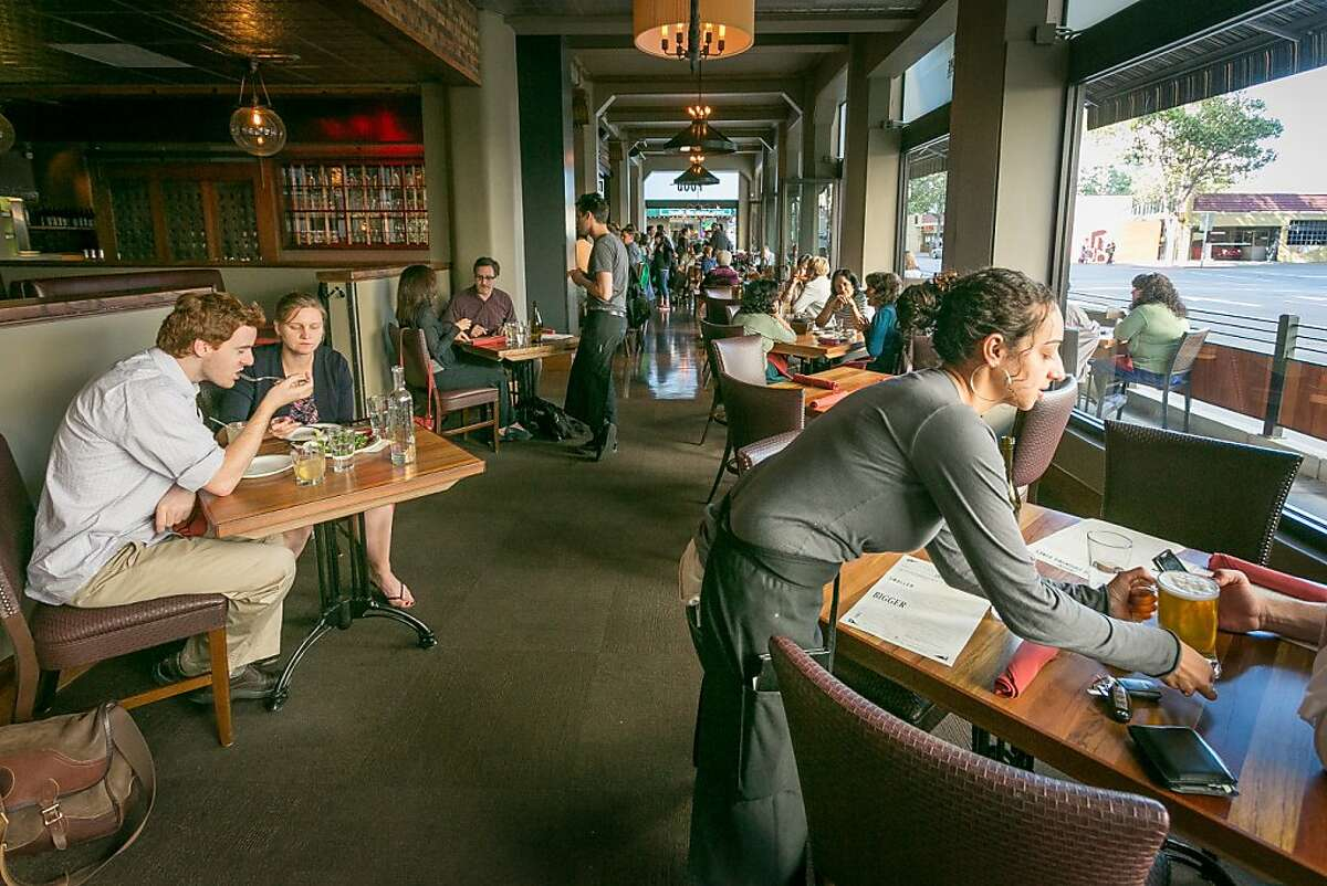 People enjoy dinner in the dining room at Tribune Tavern in Oakland, Calif., on Thursday, June 13th, 2013.