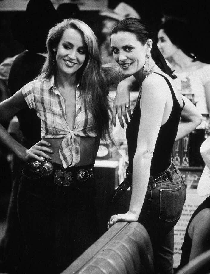 1980, American model and actor Jerry Hall and her sister, Cindy, at a party for director James Bridges's film 'Urban Cowboy' held at Gilley's, Pasadena, California. Photo: Tim Boxer, Getty / Archive Photos