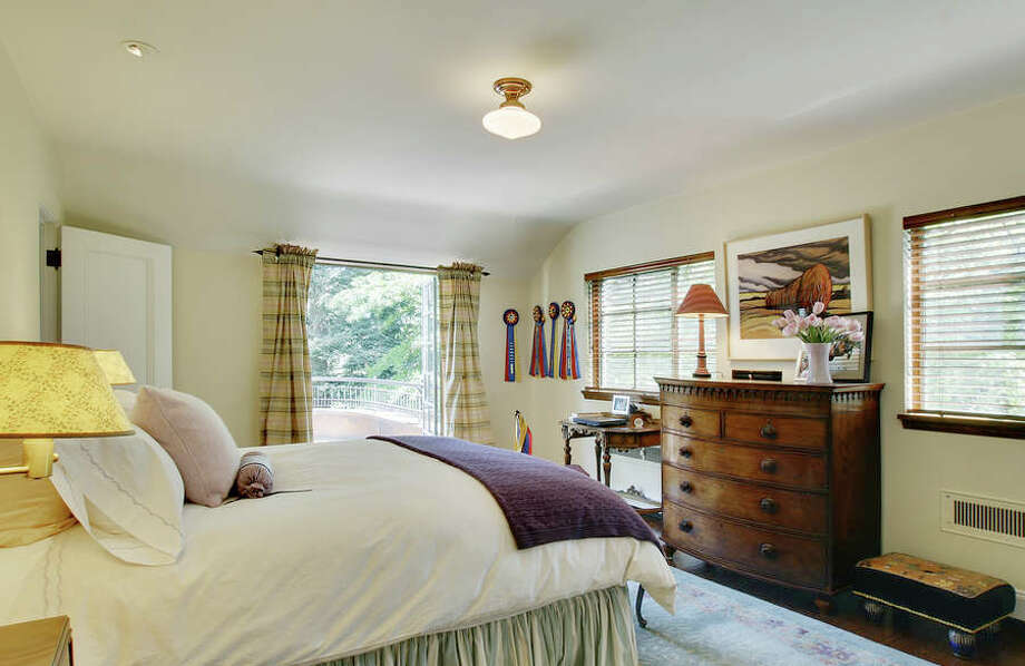 Second-floor bedroom of a house for sale on Broadmoor's eastern fairway. The 6,000-square-foot Mediterranean-style home, built in 1930, has five bedrooms, 5.5 bathrooms, a sun room, a family room, a bar, wood paneling and ceilings, French doors, wood and tile floors, patios, a fountain and a three car garage on a 19,740-square-foot lot. It's listed for $4.395 million. Photo: Buck Usher And Aaron Leitz, Courtesy Anne Willoughby Nelson, Madison House Ltd.