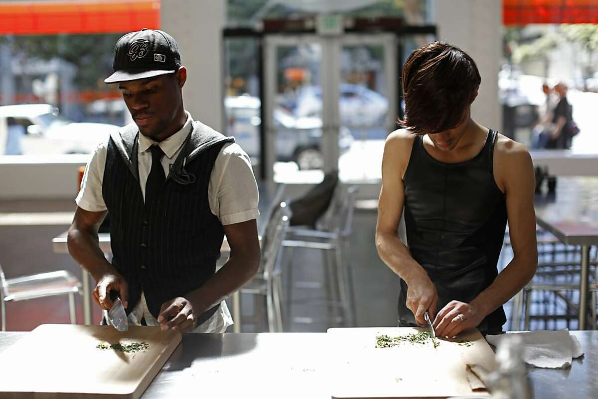 Ralph Willis, left, and Armand Seversson, right, chop tarragon leaves as a part of a cooking class from the Larkin Street Youth Services at the San Francisco Cooking School in San Francisco, Calif. on June 17, 2013.