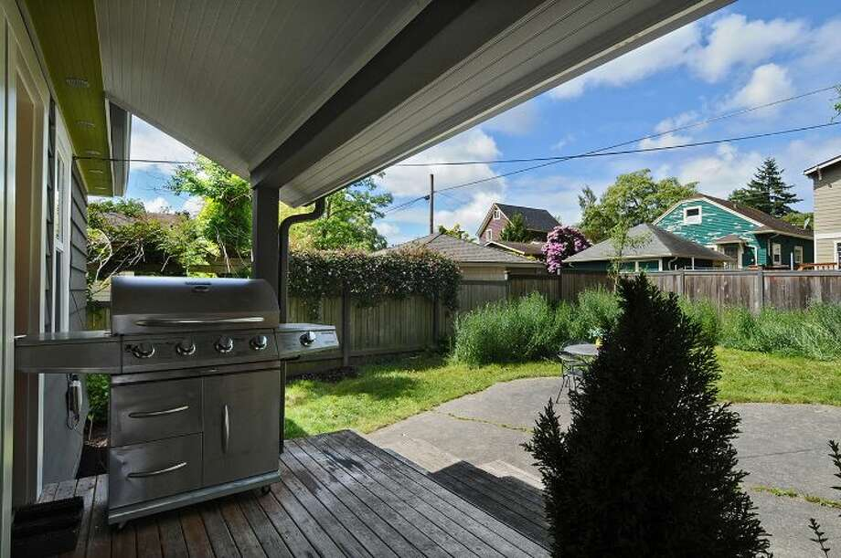 Back deck of 3225 36th Ave. S. The 1,320-square-foot Craftsman, built in 1925, has two bedrooms, one bathroom, a basement room, high ceilings, crown moldings, French doors and a patio on a 4,080-square-foot lot. It's listed for $459,950. Photo: Courtesy Dana Johnston, Windermere Real Estate