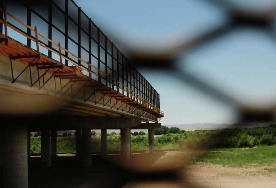 In 2006, Congress passed a law calling for about 700 miles of double-layer fencing on the border. So far, the U.S. has built about 36 miles. Photo: File Photo, Associated Press