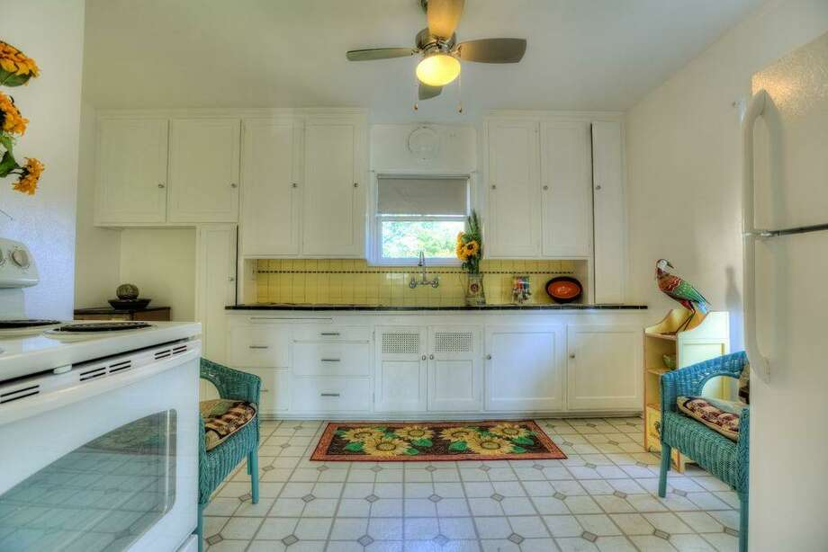 Kitchen of 2108 29th Ave. S. The 2,580-square-foot brick home, built in 1937, has three bedrooms, 1.5 bathrooms, coved ceilings, a formal dining room and a basement utility room on a 4,000-square-foot lot. It's listed for $480,000. Photo: Doh Tran, Courtesy Marlie Hirschhorn, Prudential/RNT Real Estate