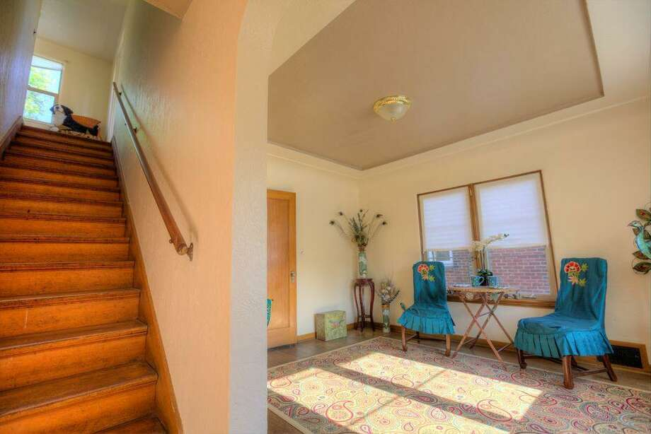 Dining room and staircase of 2108 29th Ave. S. The 2,580-square-foot brick home, built in 1937, has three bedrooms, 1.5 bathrooms, coved ceilings and a basement utility room on a 4,000-square-foot lot. It's listed for $480,000. Photo: Doh Tran, Courtesy Marlie Hirschhorn, Prudential/RNT Real Estate