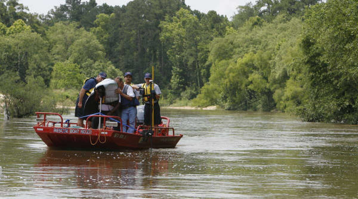 Members of EquuSearch and the Cypress Creek Fire Dept. used a sonar device as they searched Spring Creek for Randle Terry.
