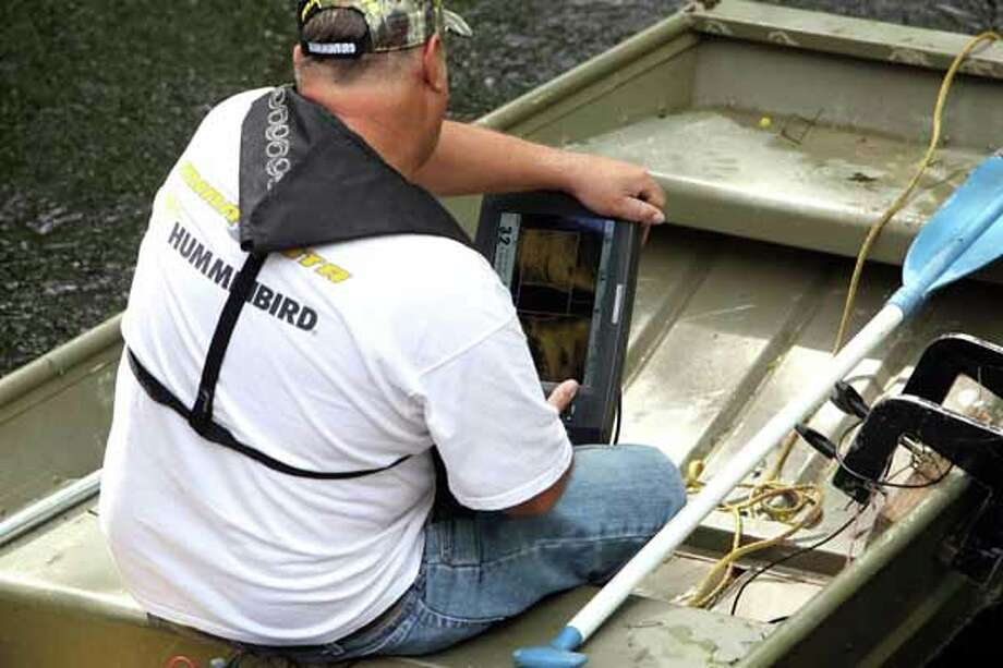Texas Equusearch used a small boat equipped with sonar to search for 2-year-old Devin Davis in a creek near his home where he went missing yesterday afternoon while his mother was taking a nap in Liberty County east of Cleveland Wednesday, March 28, 2012, in Cleveland. 